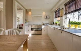 Make Your Kitchen More Spacious with These Tips apartment blinds cabinets 349749 320x202